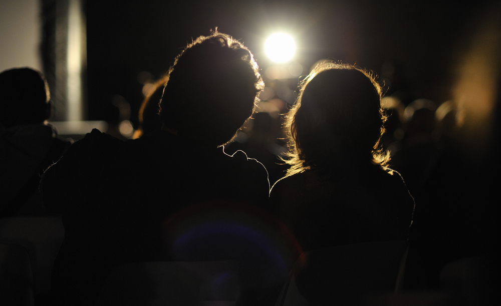 couple in a cinema projection show