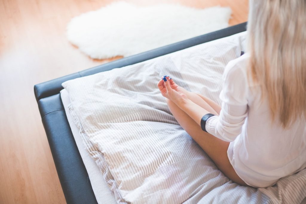 young-girl-starting-new-day-with-meditation-in-her-bed-picjumbo-com